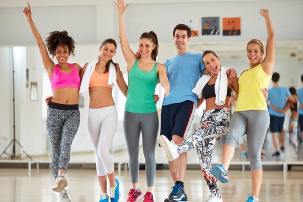 Happy team in fitness class after training